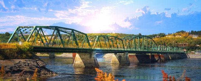 Old Saguenay Bridge and River - Stock Photo