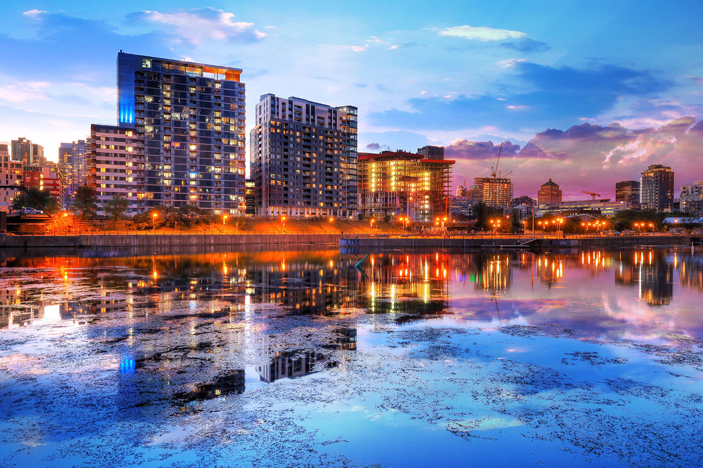 2020 Downtown Montreal City Water Reflection at Sunset - Stock Photo