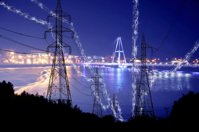 Small Town Electrification at Night in Blue - Stock Photo