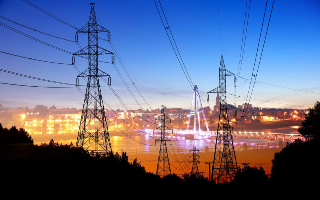 Small Town Electrification at Sunset - Stock Photo